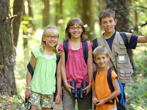 A family hiks at Homeschool Science Camp